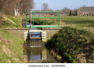 Small waterworks, sluices and dams regulate water levels in agricultural areas in The Netherlands.