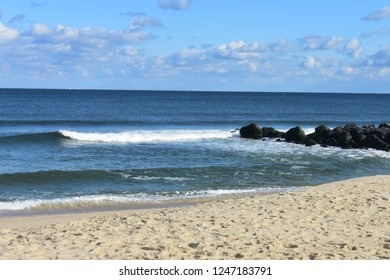 Small waves crashing into the beach at Seven Presidents Oceanfront Park in Long Branch, New Jersey -2