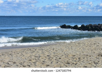 Small waves crashing into the beach at Seven Presidents Oceanfront Park in Long Branch, New Jersey -5