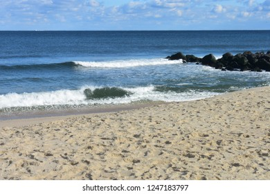 Small waves crashing into the beach at Seven Presidents Oceanfront Park in Long Branch, New Jersey -4