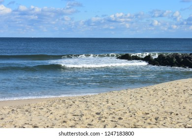 Small waves crashing into the beach at Seven Presidents Oceanfront Park in Long Branch, New Jersey -3
