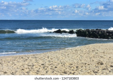 Small waves crashing into the beach at Seven Presidents Oceanfront Park in Long Branch, New Jersey -1
