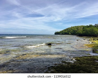 Small waves crashing over the shore of Cebu island in the tropical country Philippines. Picture taken on a clear bright sunny afternoon.