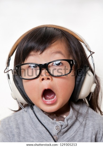 small wearing glass listening to music