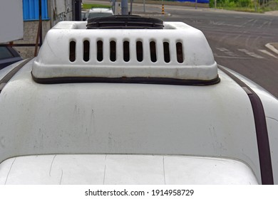 Small white aerodynamic cooling box at car roof