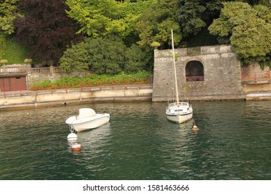 Small White Boats on Water