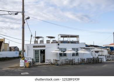 A small white cafe building nearby Hasudong Beach in Udo Island. Taken in Hasudong Beach, Jeju Island South Korea on December 6th 2018