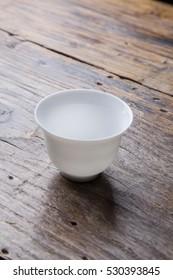 Small white ceramic cup