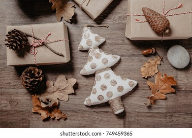 Small white Christmas tree with Christmas or New year gifts. Holiday decor concept. Toned picture. Top View. Flat lay.