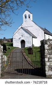A small white church in Cardiganshire blue sky background