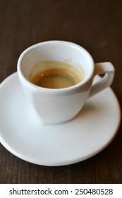 Small white cup of espresso coffee