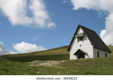 small white house in the mountain