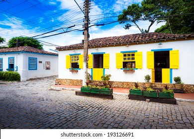 Small white houses with colorful window shutters in Buzios, Brazil