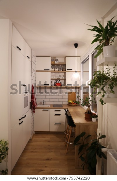 Small white kitchen, red components