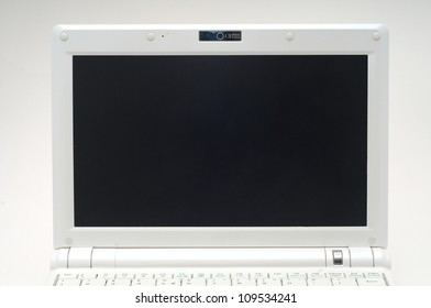 Small white laptop display isolated on gradient background with black display to put your image