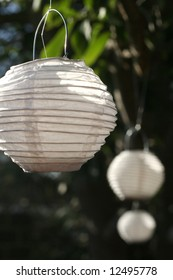Small white paper lanterns in the daylight