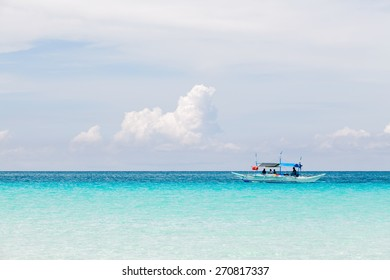 Small white ship on the blue sea