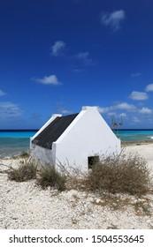 Small white slave hut on Bonaire island in the caribbean sea