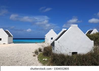 Small white slave huts on Bonaire island in the caribbean sea