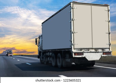 Small White Truck on highway road with  container, transportation concept.,import,export logistic industrial Transporting Land transport on the asphalt expressway Against Sky During Sunset