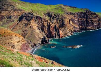 small wild beach lost in the cliffs of Ponta de Sao Lourenco, Madeira, Portugal