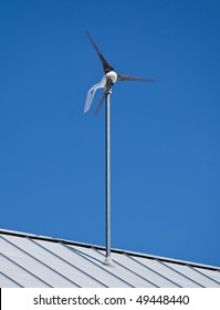 a small wind turbine windmill attached to a roof