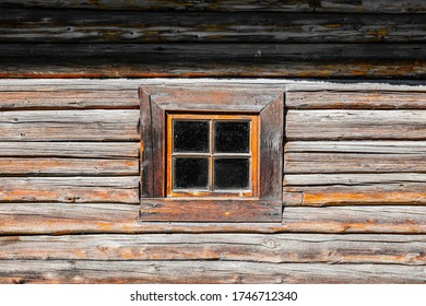 small window in an old wooden house In Estonian village