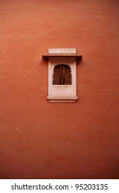 Small Window on Red Wall