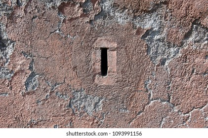 small window for ventilation in a cement wall