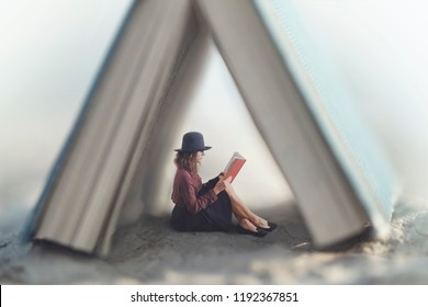 small woman reading a book law protected by a house made from a giant book