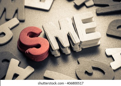 Small wood letters of SME, abbreviation of Small and Medium Sized Enterprise