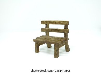 Small wooden bench model with isolated on white background.