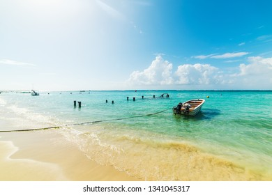 Small wooden boat moored in beautiful Sainte Anne beach in Guadeloupe, French west indies. Lesser Antillles, Caribbean sea