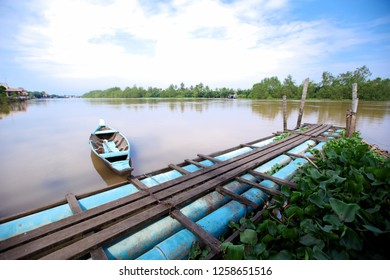 Small wooden boat on the banks of the river.