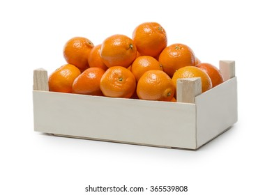 Small wooden Box with Clementines isolated on white background