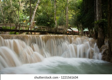 Small wooden bridge leading over Tad Sae Waterfall in Luang Prabang Province, Laos.