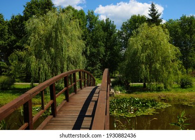 A small wooden bridge over a lake or river