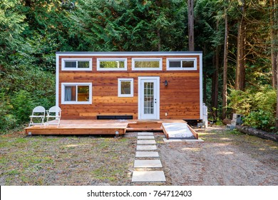 Small wooden cabin house. Exterior design.
