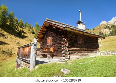 small wooden cabin on Alps Dolomites mountains