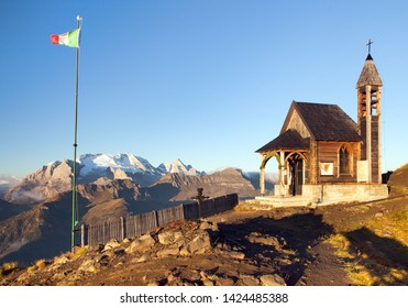 Small wooden church or chapel on the mountain top Col di Lana and Mount Marmolada, Alps Dolomites mountains, Italy