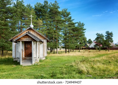 Small wooden church, trees, blue sky