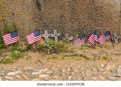 Small Wooden Crosses and American Flags on Omaha Beach in Normandy France
