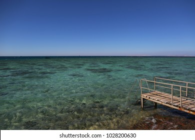 Small wooden dock with view on Mediterranean sea. Travel and vacation concept.