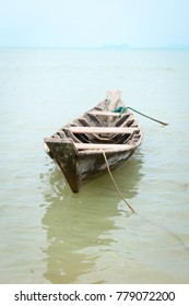 Small wooden fishing boat in calm water