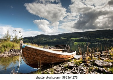 Small wooden fishing boat in Norwegian fjord