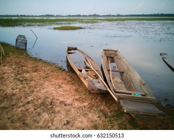 Small wooden fishing boats near the swamp.