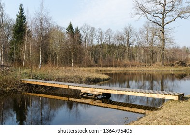 Small wooden footbridge in the countryside by springtime