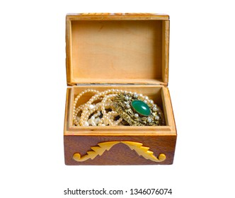 Small wooden handmade casket with jewelry. Isolated on white background.