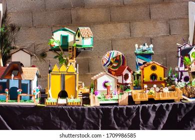 Small wooden handmade houses for sale on Porreres Market. Porreres, Majorca, Spain