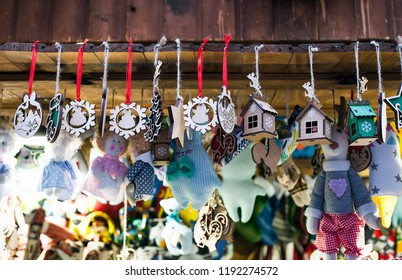 Small wooden handmade toys selling at Xmas Fair. Christmas market with traditional decorations close up. Holidays kiosk with festive gifts and souvenirs at Lviv city street in Ukraine